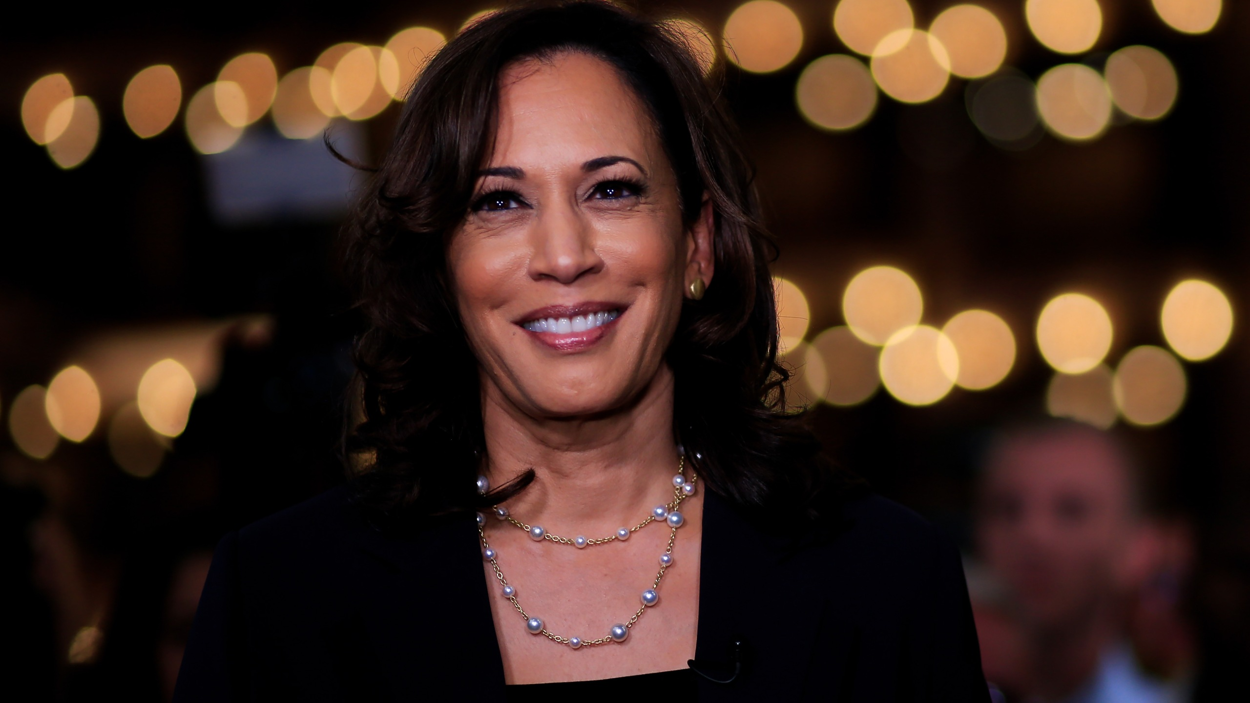 Democratic presidential candidate Sen. Kamala Harris (D-CA) speaks during a television interview after the second night of the first Democratic presidential debate on June 27, 2019, in Miami, Fla. (Credit: Cliff Hawkins/Getty Images)