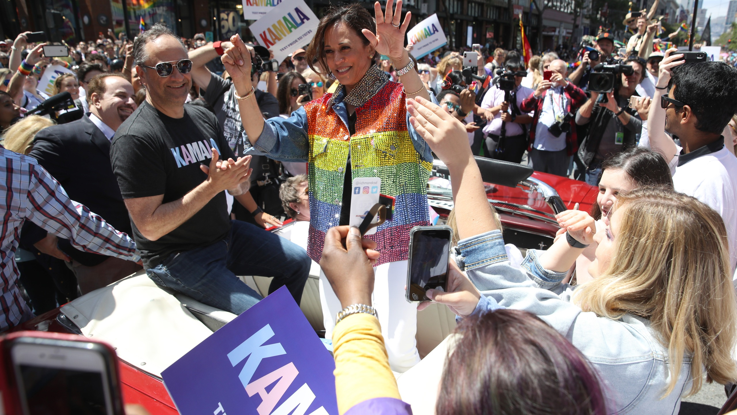 Democratic presidential candidate U.S. Sen. Kamala Harris (D-CA) waves as she rides in a car during the San Francisco Pride Parade on June 30, 2019. (Credit: Justin Sullivan/Getty Images)
