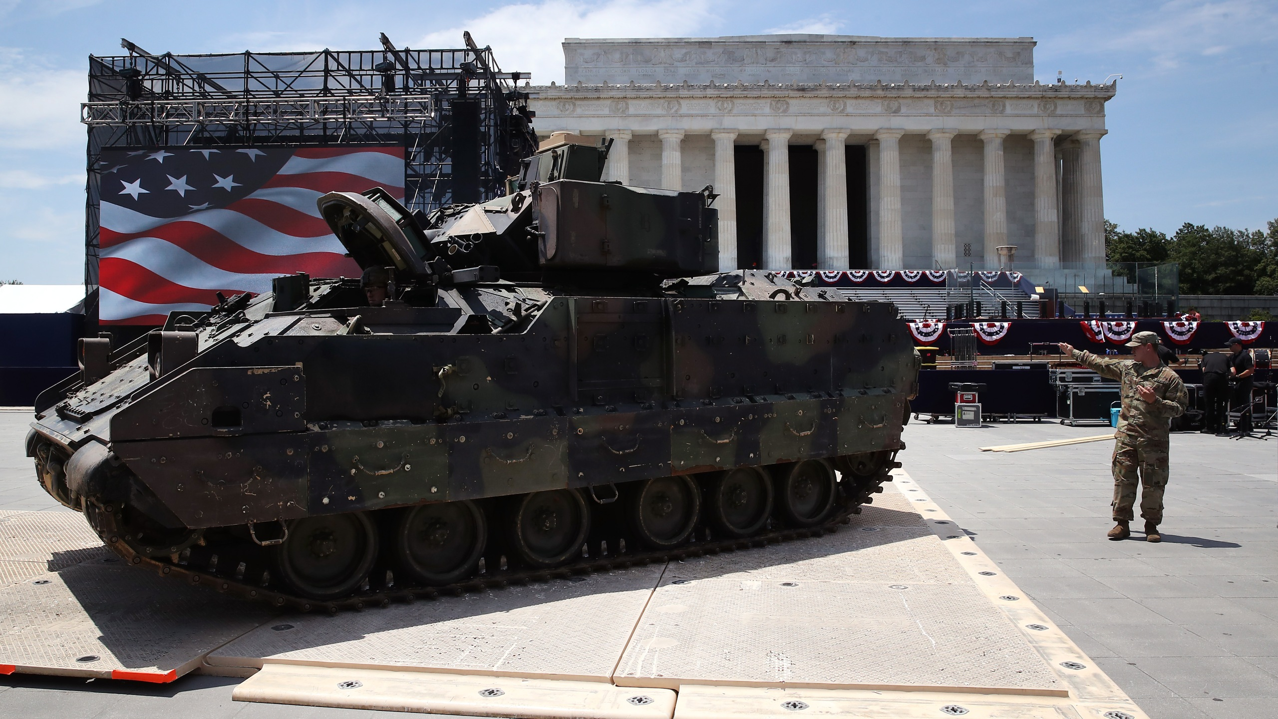 """Members of the U.S. Army park an Bradley fighting vehicle in front of the Lincoln Memorial ahead of the Fourth of July """"Salute to America"""" celebration on July 3, 2019 in Washington, DC. (Credit: Mark Wilson/Getty Images)"""