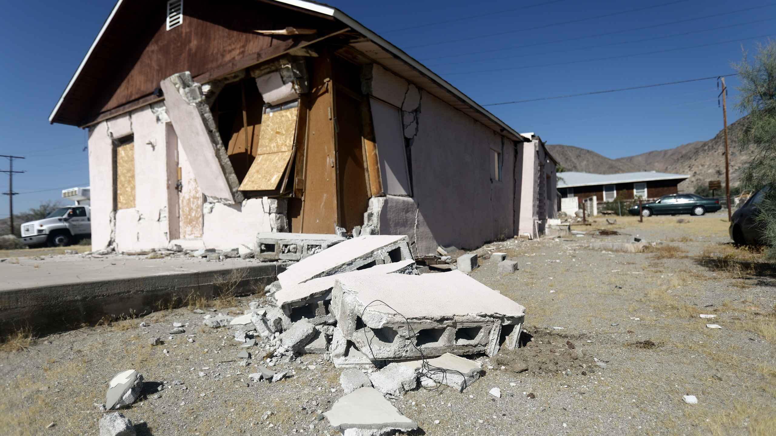 A house is damaged after a 7.1 magnitude earthquake struck in the area on July 6, 2019 in Trona, Calif. (Credit: Mario Tama/Getty Images)