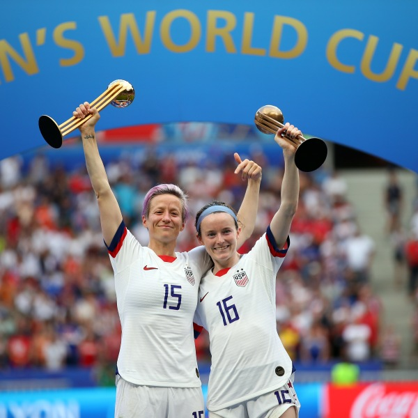 Megan Rapinoe of team USA celebrates with the Golden Ball award and teammate Rose Lavelle celebrates with the Bronze Ball award following the 2019 FIFA Women's World Cup France Final match at Stade de Lyon on July 7, 2019 in Lyon, France. (Credit: Richard Heathcote/Getty Images)