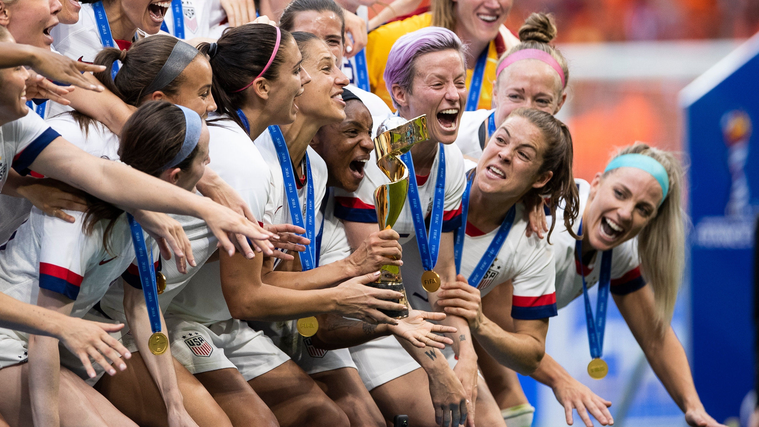 Players of the U.S. Women's National Team celebrate with their trophy after winning the 2019 FIFA Women's World Cup over the Netherlands in Lyon, France, on July 7, 2019. (Credit: Maja Hitij / Getty Images)
