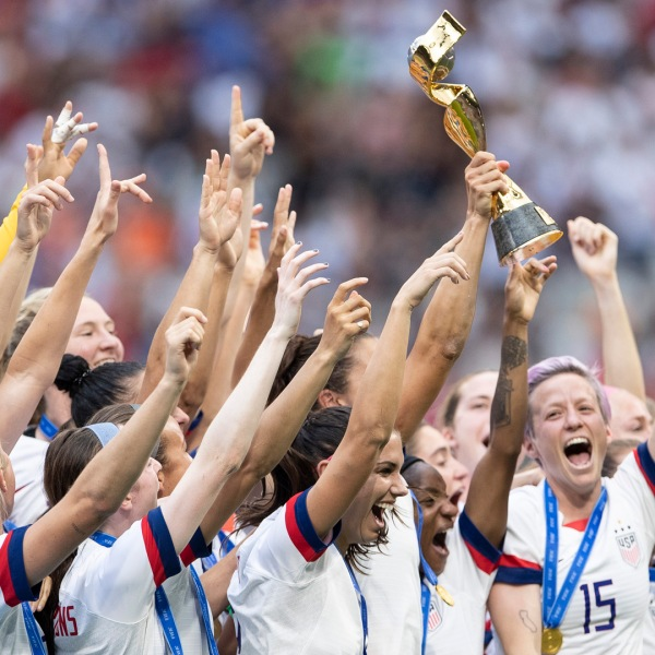 The U.S. Women's National Team celebrates with the FIFA Women's World Cup Trophy following team's victory in the 2019 FIFA Women's World Cup France Final match between The United States of America and The Netherlands at Stade de Lyon on July 07, 2019 in Lyon, France. (Credit: Maja Hitij/Getty Images)