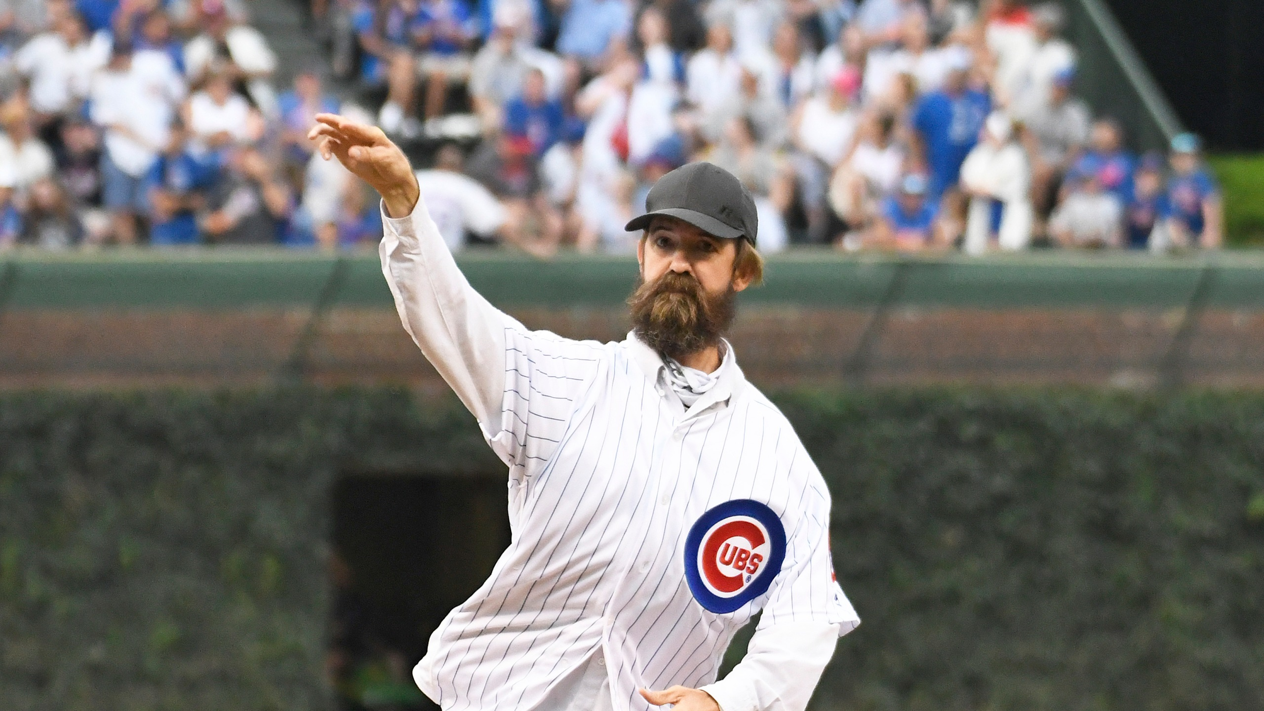 Alligator expert and trapper Frank Robb throws out a ceremonial first pitch before the game between the Chicago Cubs and the Cincinnati Reds at Wrigley Field on July 16, 2019. (Credit: David Banks/Getty Images)