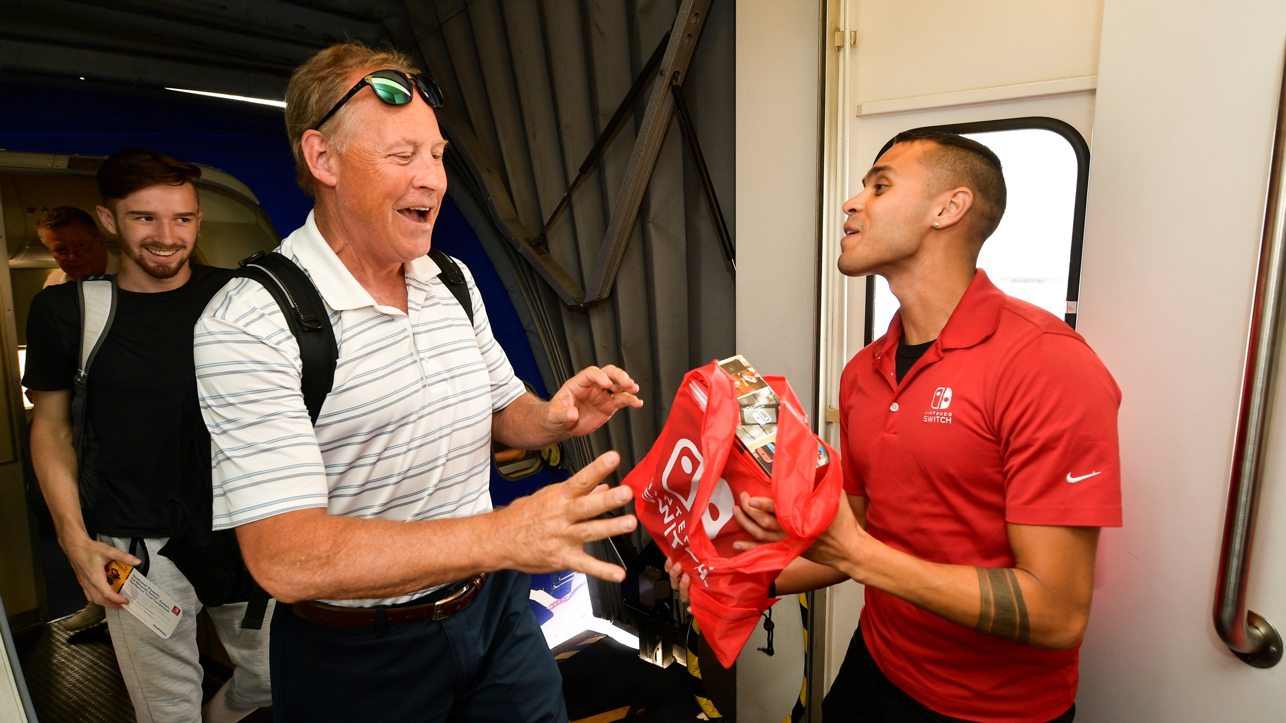 Southwest Airlines passengers are surprised with their own Nintendo Switch system at San Diego International Airport on July 17, 2019. (Credit: Matt Winkelmeyer/Getty Images for Nintendo)