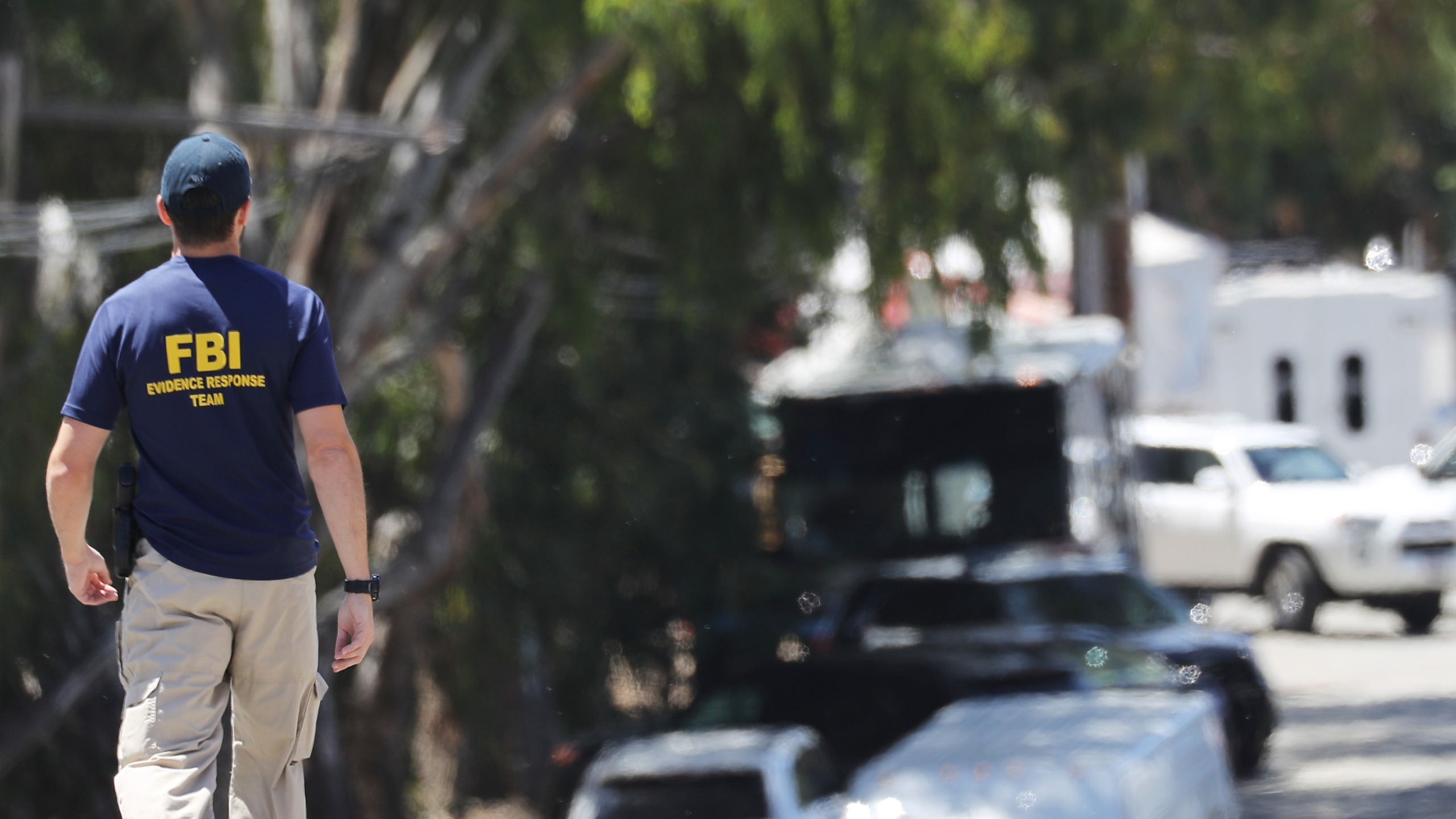 An FBI agent walks toward the site of the Gilroy Garlic Festival after a mass shooting took place there yesterday on July 29, 2019 in Gilroy, California. (Credit: Mario Tama/Getty Images)