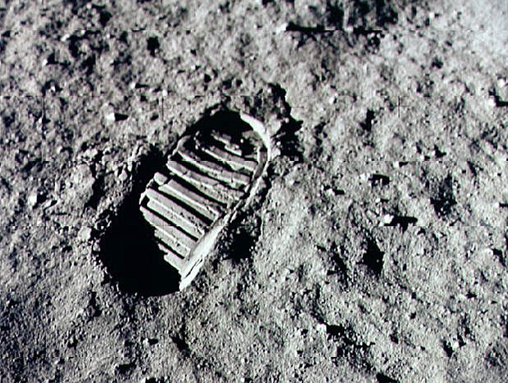 Neil Armstrong steps into history July 20, 1969 by leaving the first human footprint on the surface of the moon. (Credit: NASA/Newsmakers)