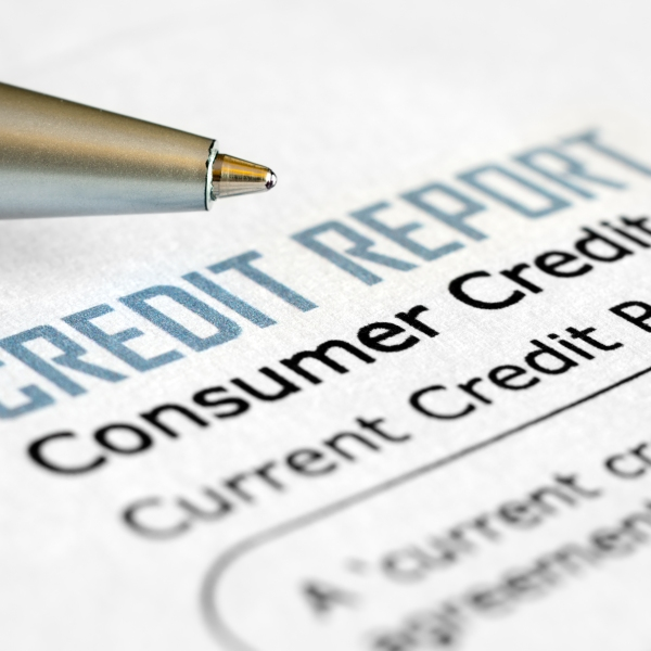 A pen and credit report document are seen in a file photo. (Credit: Getty Images)