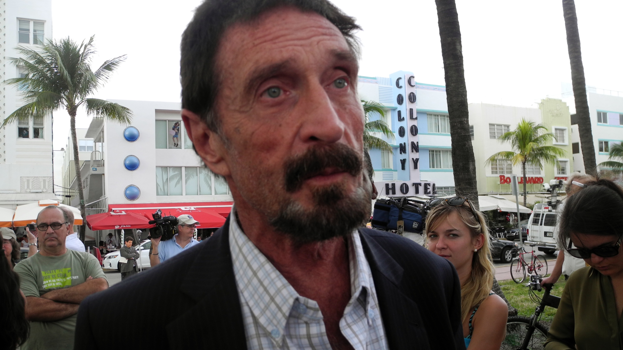 Software company founder John McAfee speaks in front of this hotel in Miami Beach, Florida on December 13, 2012, a day after being deported to US from Guatemala, where was detained for immigration violations. (Credit: PAULA BUSTAMANTE/AFP/Getty Images)