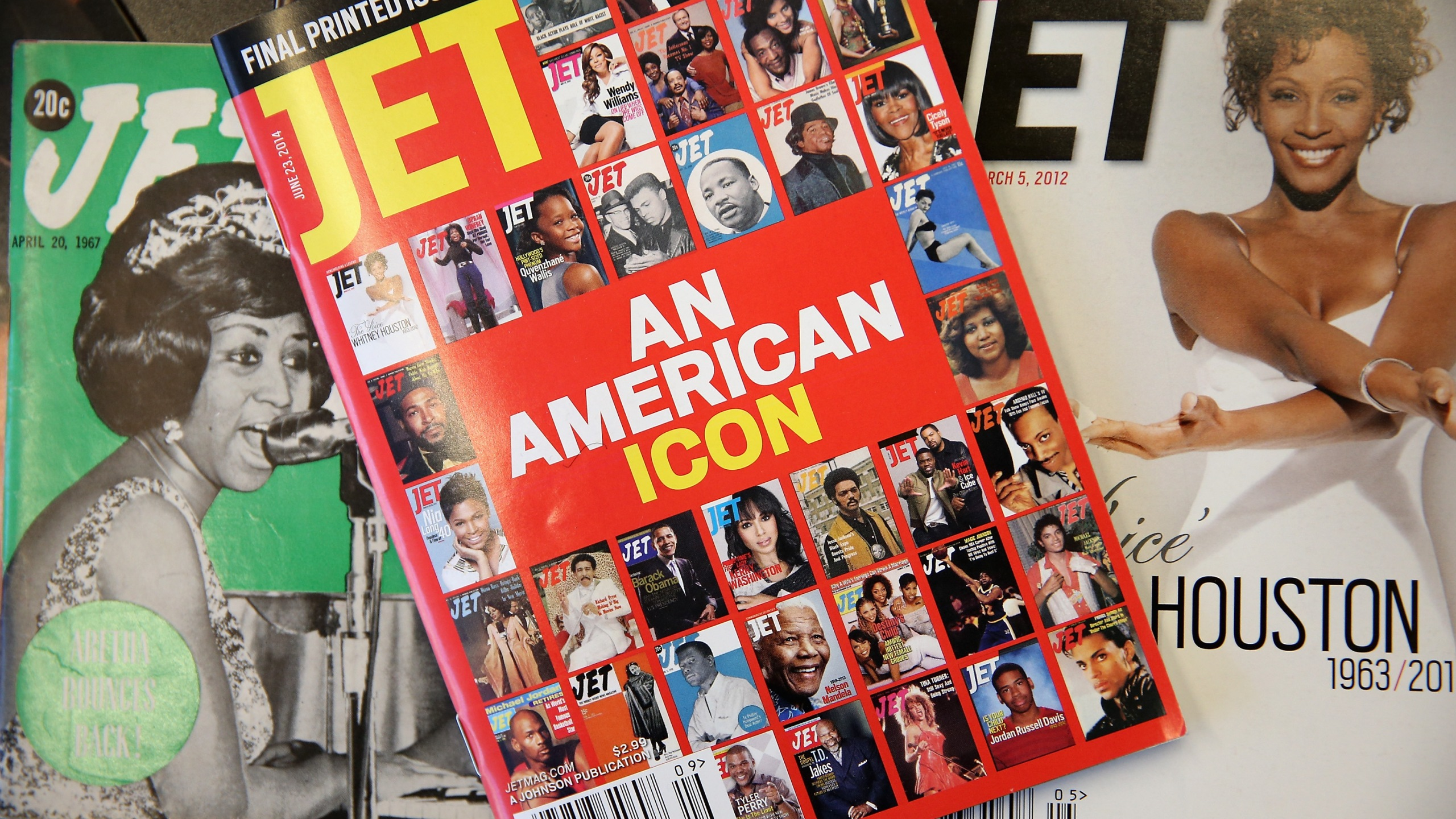 """The final print edition of Jet magazine with a cover declaring it """"an American icon"""" is displayed with vintage copies of the magazine at the Chicago offices of Johnson Publishing Company on June 9, 2014. (Credit: Scott Olson / Getty Images)"""