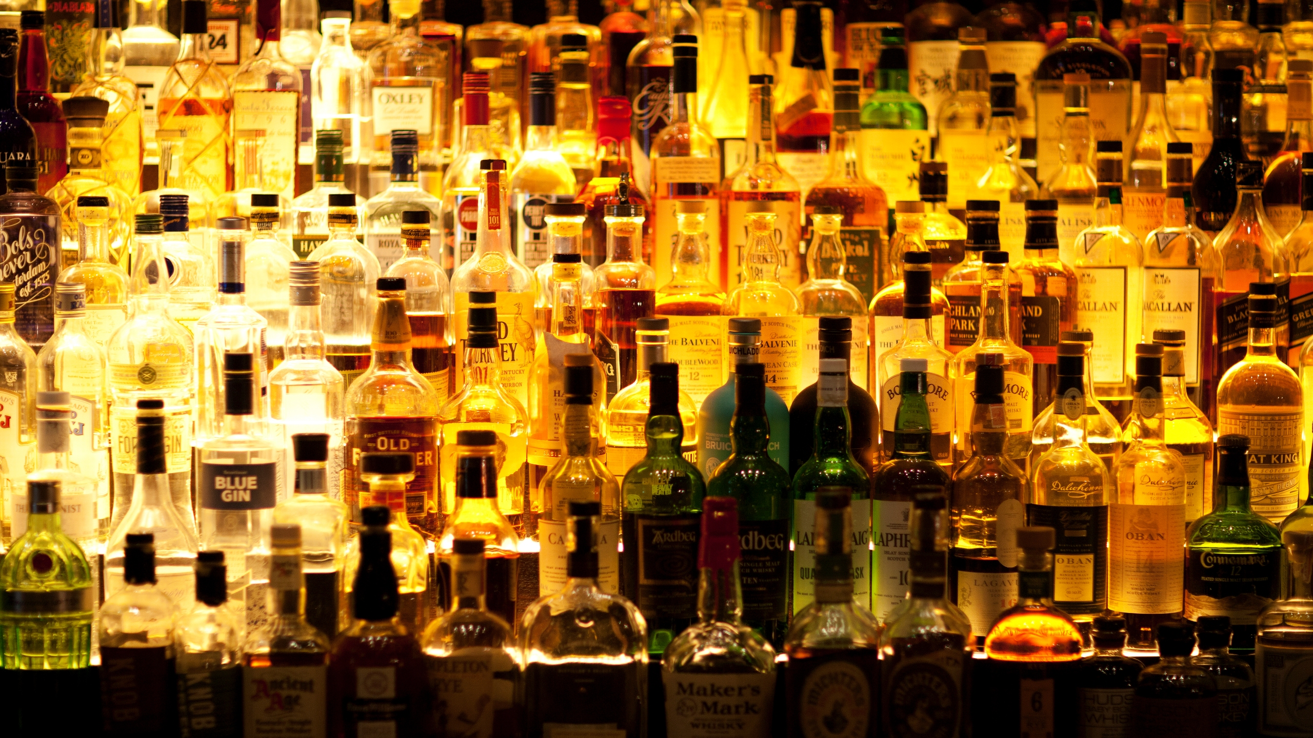 Various liquor bottles are pictured behind a bar in this undated image. (Credit: Getty Images)