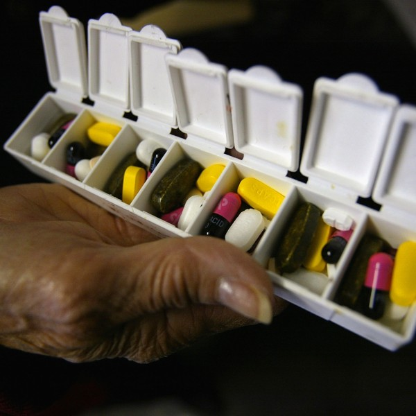 Carole Jaquez displays a box of pills for her asthma and high blood pressure condition purchased in Canada at a 58.9% savings on Oct. 12, 2004 in New York City. (Credit: Spencer Platt/Getty Images)