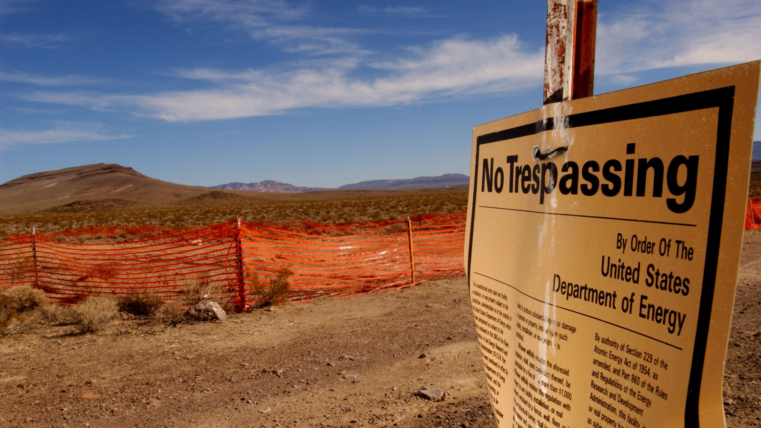 A warns people to stay away from the designated nuclear waste dump site of Yucca Mountain on Feb. 7, 2002, at Nellis Air Force Base. (Credit: David McNew/Getty Images)