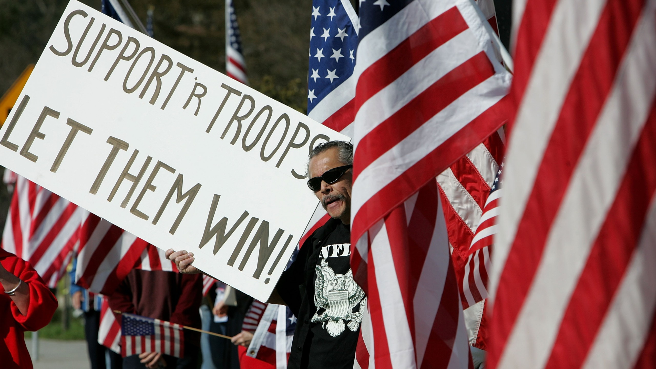 A pro-war demonstrator holds a sign as he participates in a rally staged by Move America Forward at the site of a hillside memorial honoring U.S. troops killed in Iraq March 8, 2007 in Lafayette, California. (Credit: Justin Sullivan/Getty Images)