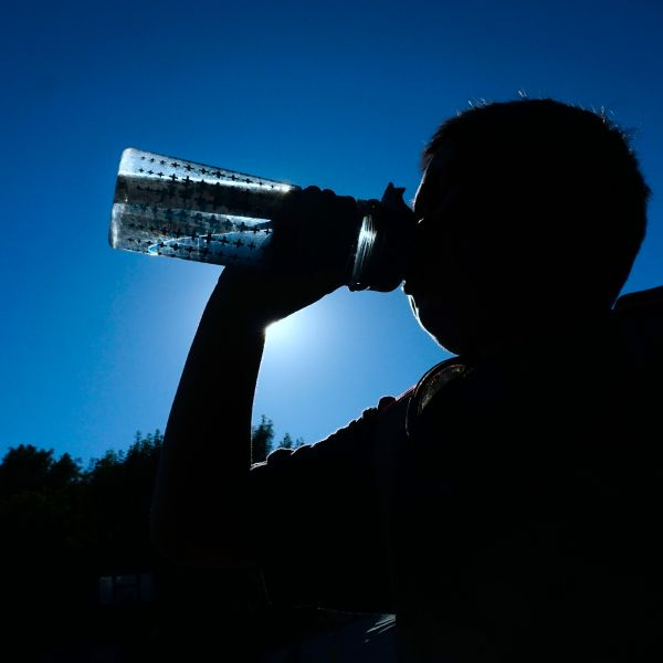 A child drinks from his water bottle amid an ongoing heatwave in Los Angeles on June 26, 2017. (Credit: FREDERIC J. BROWN/AFP/Getty Images)