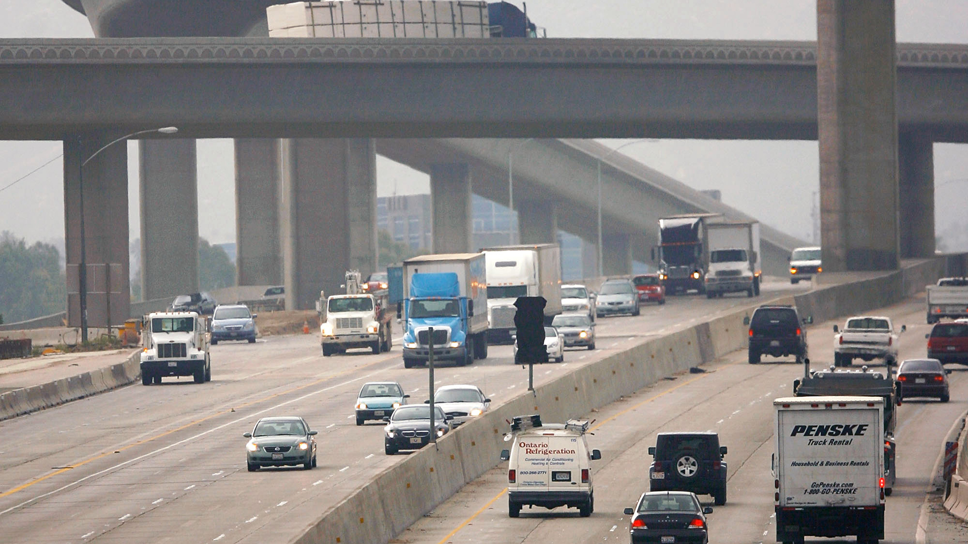 Traffic moves along the 60 Freeway in Riverside in this file photo. (Credit: David McNew/Getty Images)