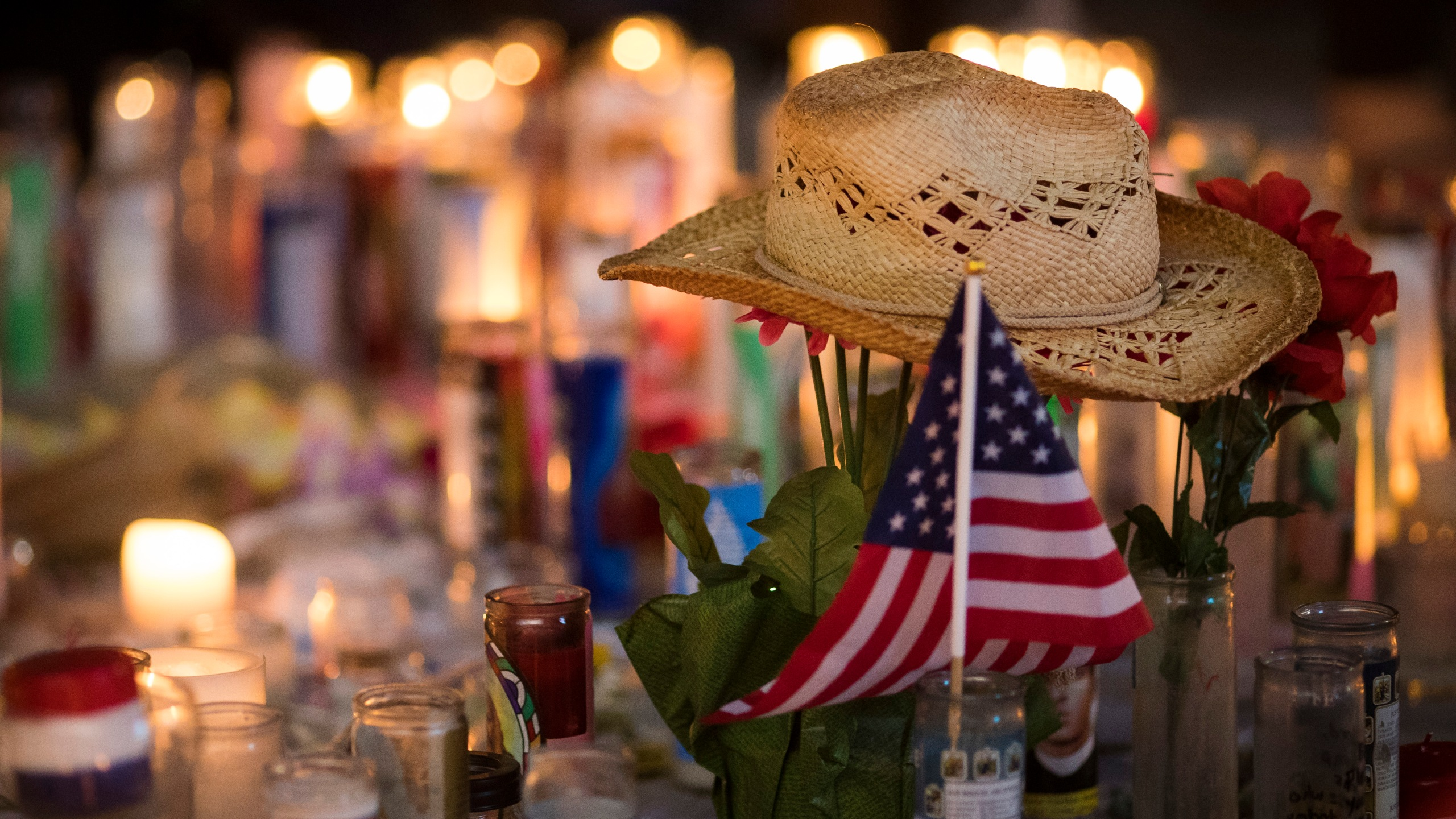 A hat is left at a makeshift memorial during a vigil to mark one week since the mass shooting at the Route 91 Harvest country music festival in Las Vegas, Nevada. (Credit: Drew Angerer/Getty Images)