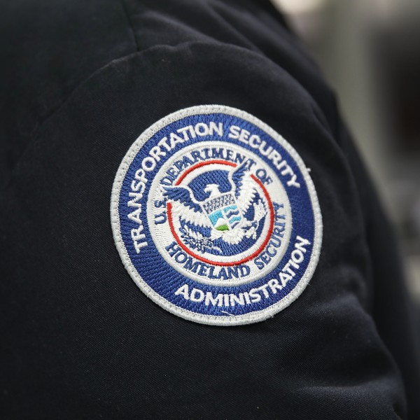 A patch is seen on the jacket of a Transportation Security Administration official as he works at the automated screening lanes funded by American Airlines and installed by the Transportation Security Administration at Miami International Airport on October 24, 2017 in Miami, Florida. (Credit: Joe Raedle/Getty Images)