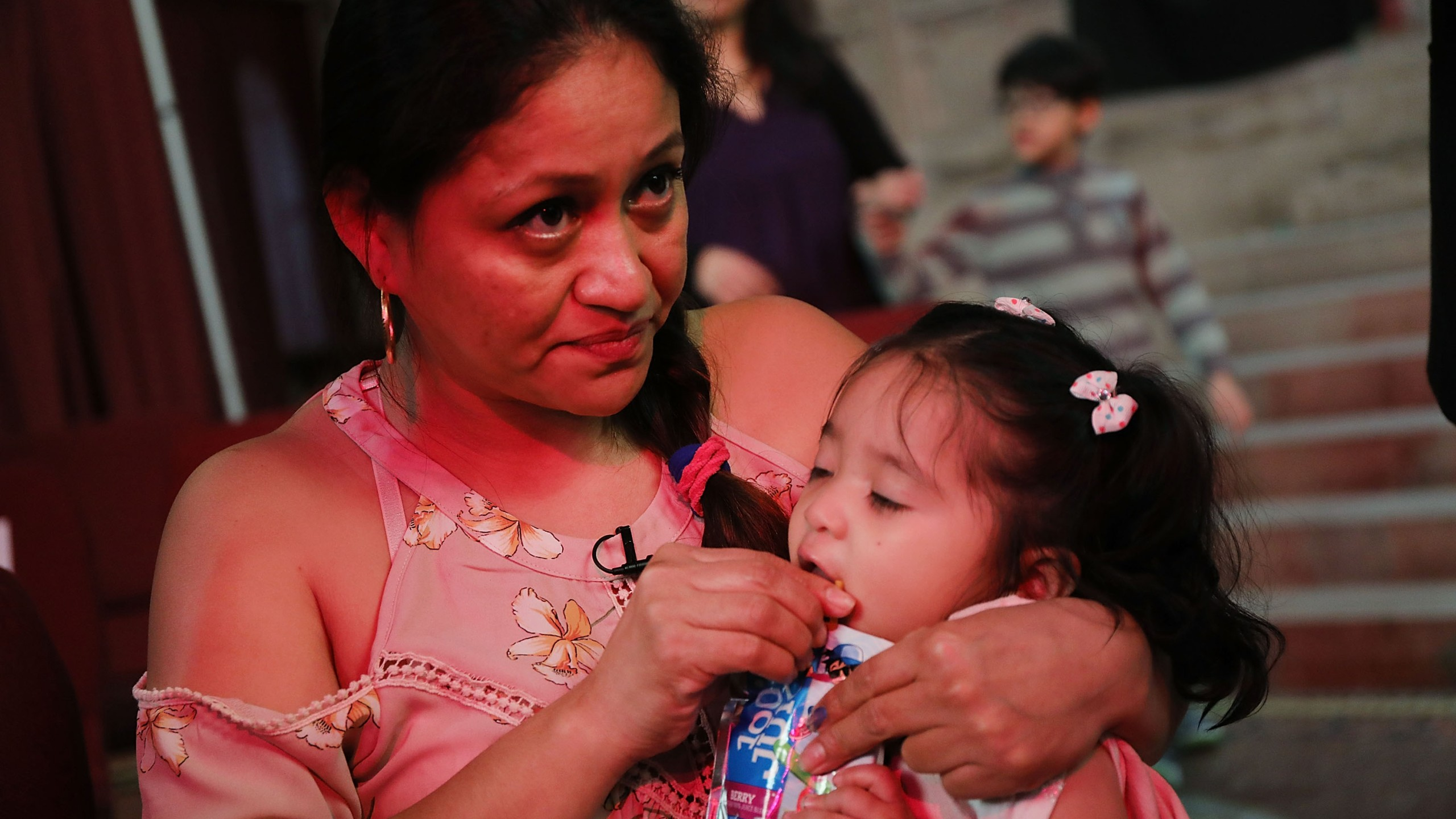 Aura Hernandez, a 37-year-old woman from Guatemala taking sanctuary in a Manhattan church, holds her 15-month-old daughter during a vigil on March 29, 2018. (Credit: Spencer Platt / Getty Images)