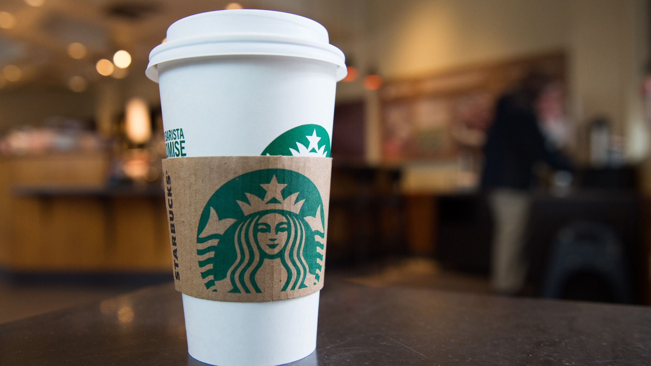 A Starbucks coffee cup is seen inside a Starbucks Coffee shop in Washington, DC, on April 17, 2018. (Credit: Saul Loeb/AFP/Getty Images)