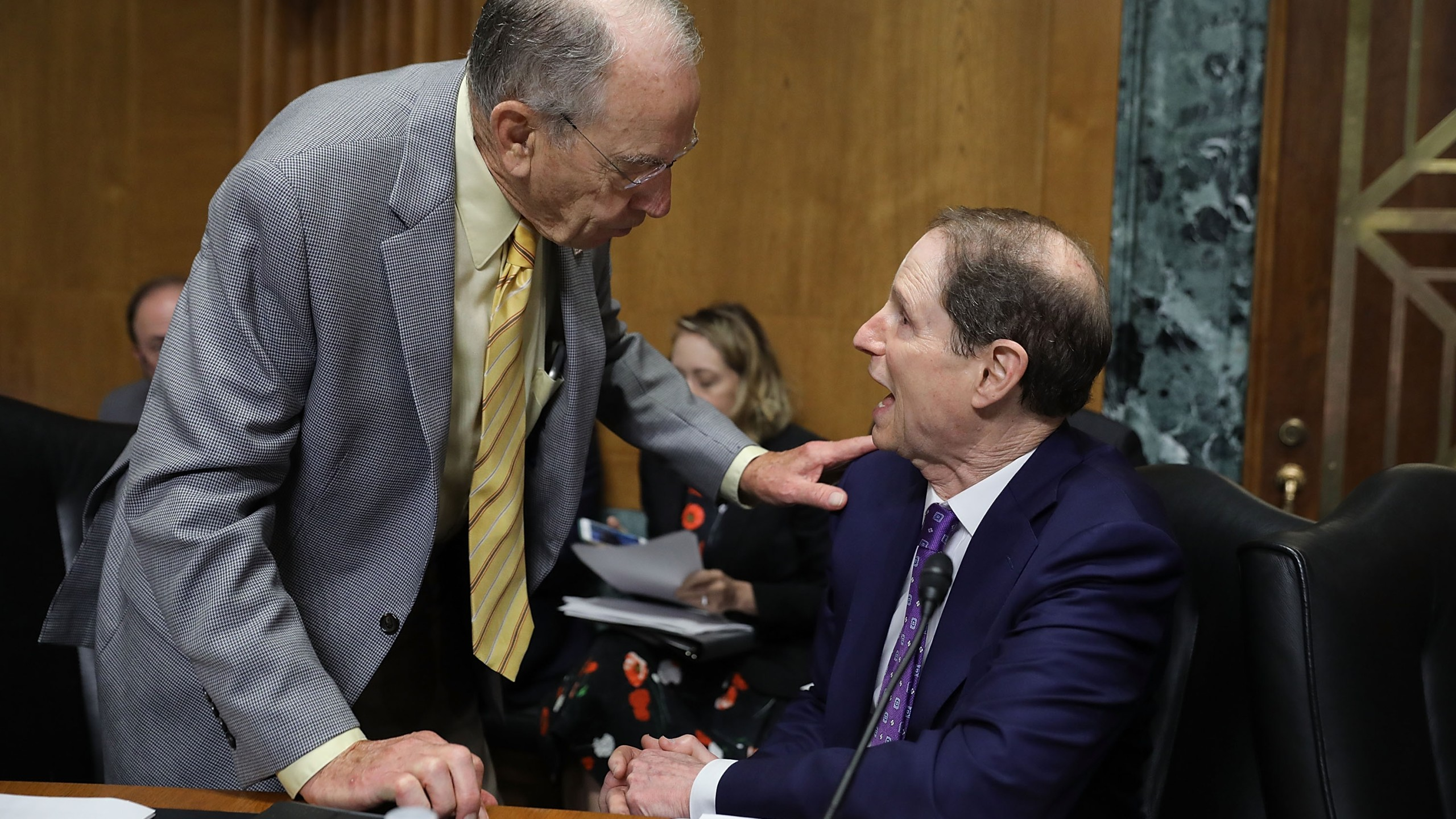 Senate Finance Committee member Sen. Charles Grassley (R-IA) (L) talks with committee ranking member Sen. Ron Wyden (D-OR) before a hearing with U.S. Secretary of Commerce Wilbur Ross in the Dirksen Senate Office Building on Capitol Hill June 20, 2018 in Washington, DC. (Credit: Chip Somodevilla/Getty Images)