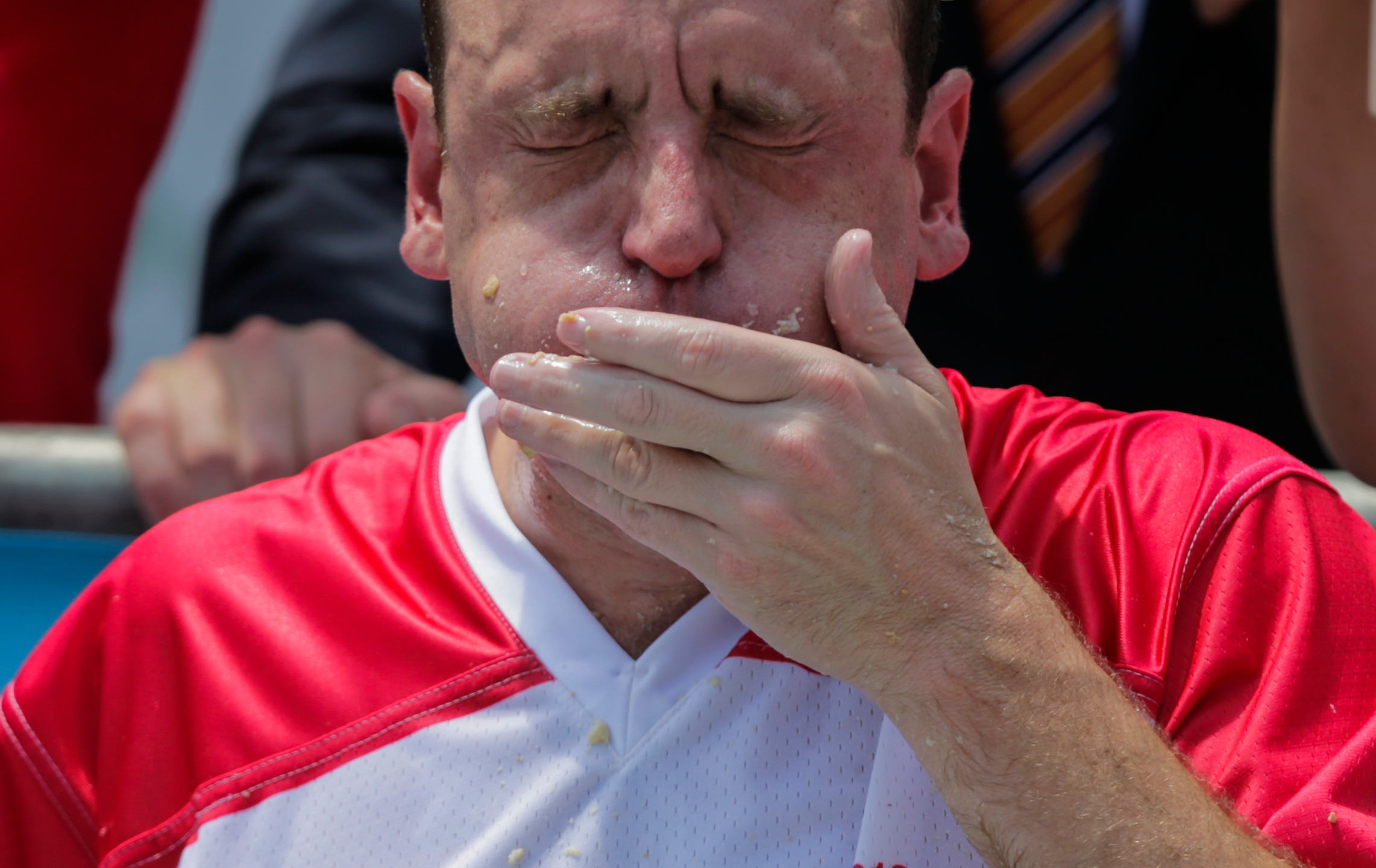 Joey Chestnut competes in the annual Nathan's Hot Dog Eating Contest on July 4, 2018 in the Coney Island neighborhood of the Brooklyn borough of New York City. (Credit: Eduardo Munoz Alvarez/Getty Images)