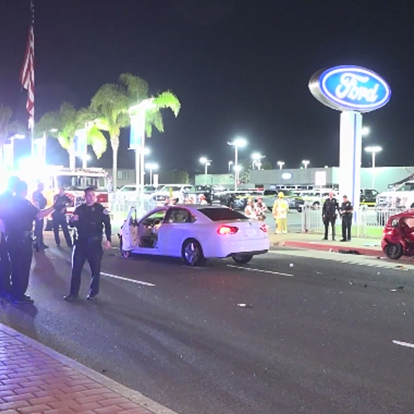 Officials investigate a fatal crash in Huntington Beach on July 22, 2019. (Credit: OnScene.TV)