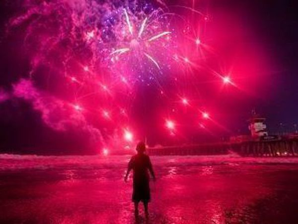 A child watches Fourth of July fireworks in Huntington Beach on July 4, 2019. (Allen J. Schaben/Los Angeles Times)