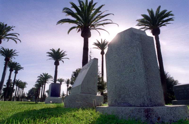 Palm trees surround the graves and headstones in Santa Ana Cemetery, seen here in 1996. (Credit: Christine Cotter/ Los Angeles Times)