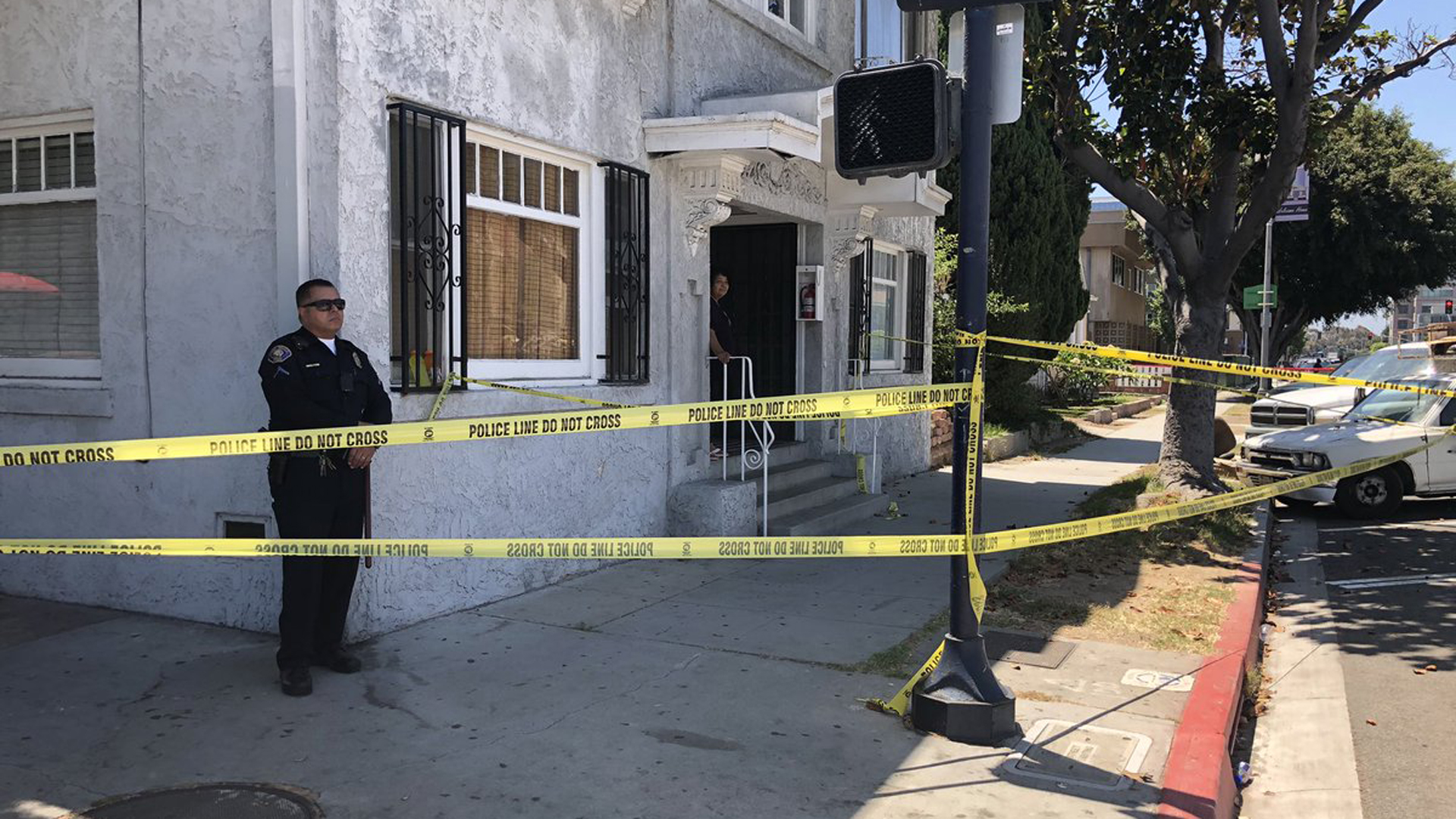 Police investigated a shooting that left a woman dead in Long Beach on July 11, 2019. (Credit: Carlos Saucedo / KTLA)