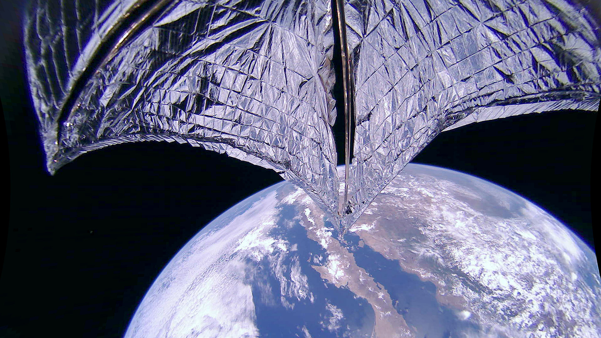 This de-distorted and cold corrected image was taken during the LightSail 2 sail deployment sequence on 23 July 2019 at 11:48 a.m. (Credit: Planetary Society)