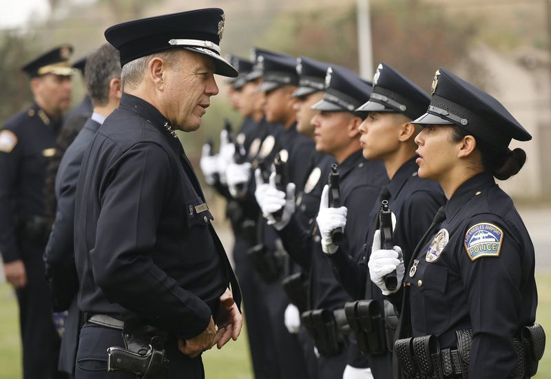 Chief Michel Moore, left, speaks to an officer in an undated photo. (Credit: Al Seib/Los Angeles Times)