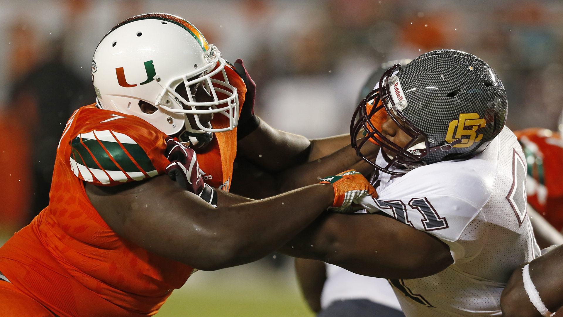 Kendrick Norton of the Miami Hurricanes, left, battles Phillip Norman of the Bethune-Cookman Wildcats during third quarter action on September 5, 2015 at Sun Life Stadium in Miami Gardens, Florida. (Credit: Joel Auerbach/Getty Images)
