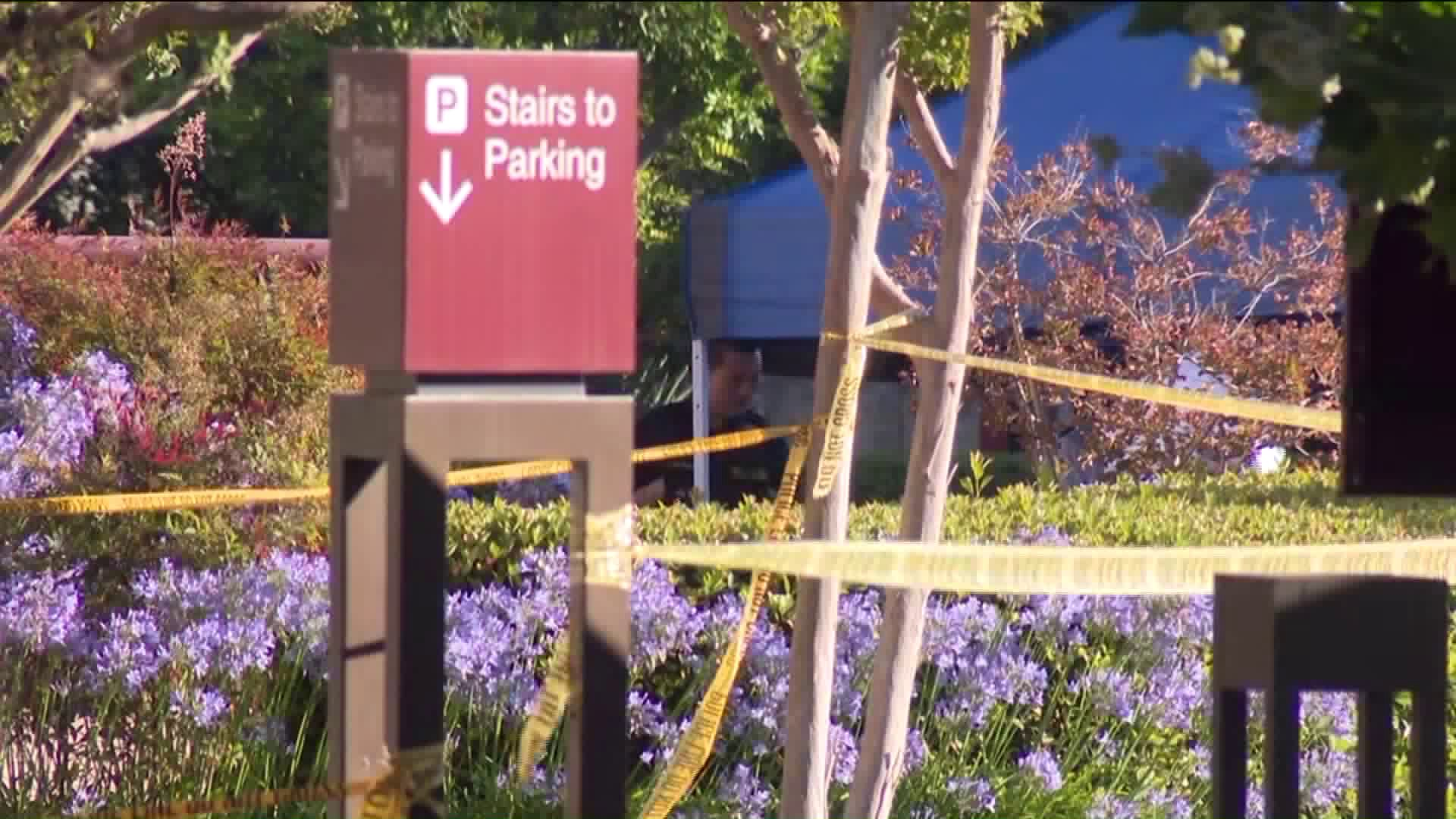 Detectives investigate the death of a woman whose body was discovered in a parking lot in the 100 block of Alessandro Place in Pasadena on July 14, 2019. (Credit: KTLA)