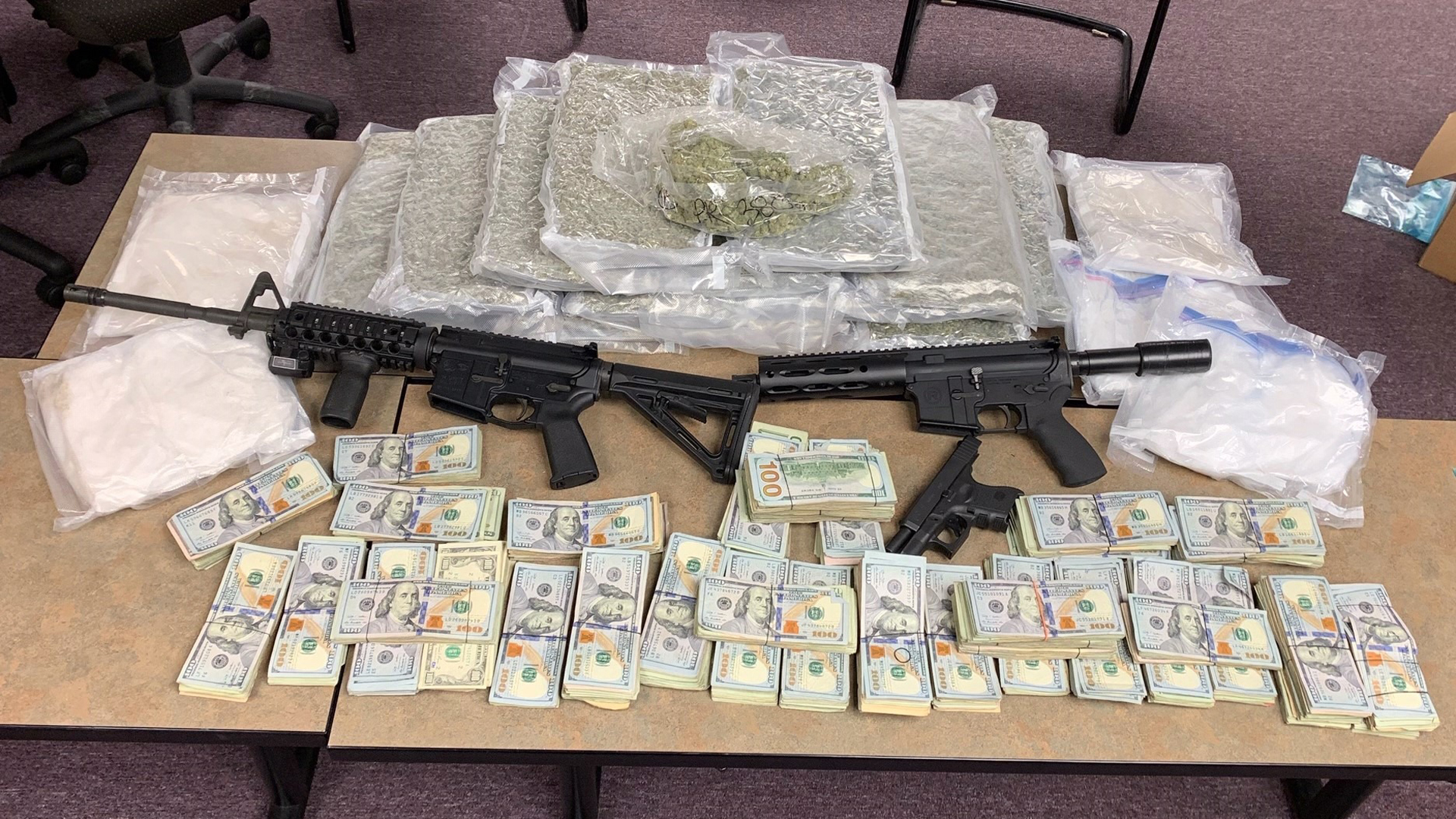 The Georgia Bureau of Investigation released this photo of drugs, firearms and cash seized in the raid.