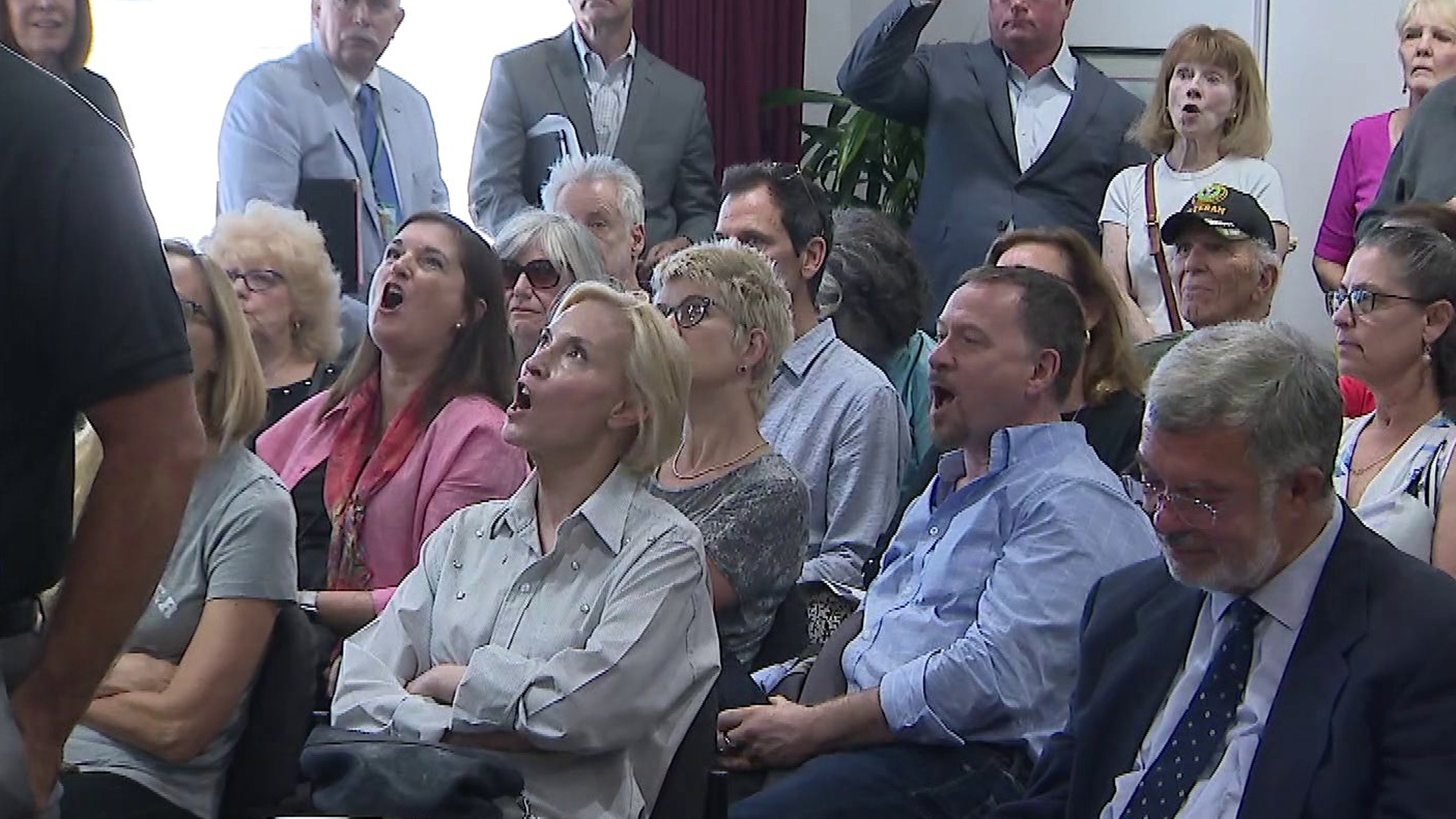 Residents attend a Burbank Airport Authority meeting on July 15, 2019, where they criticized elected leaders for not resolving noise and environmental complaints due to the paths of flights. (Credit: KTLA)