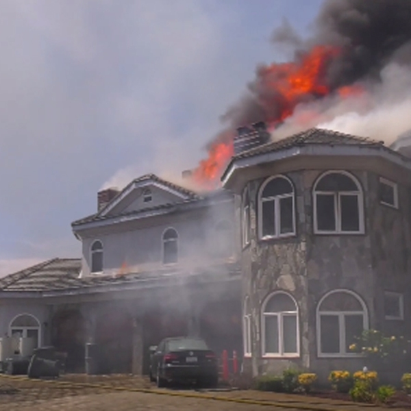 A home is seen burning in Chino Hills on July 28, 2019, as the Star Fire burned through at least 80 acres. (Credit: RMG News)