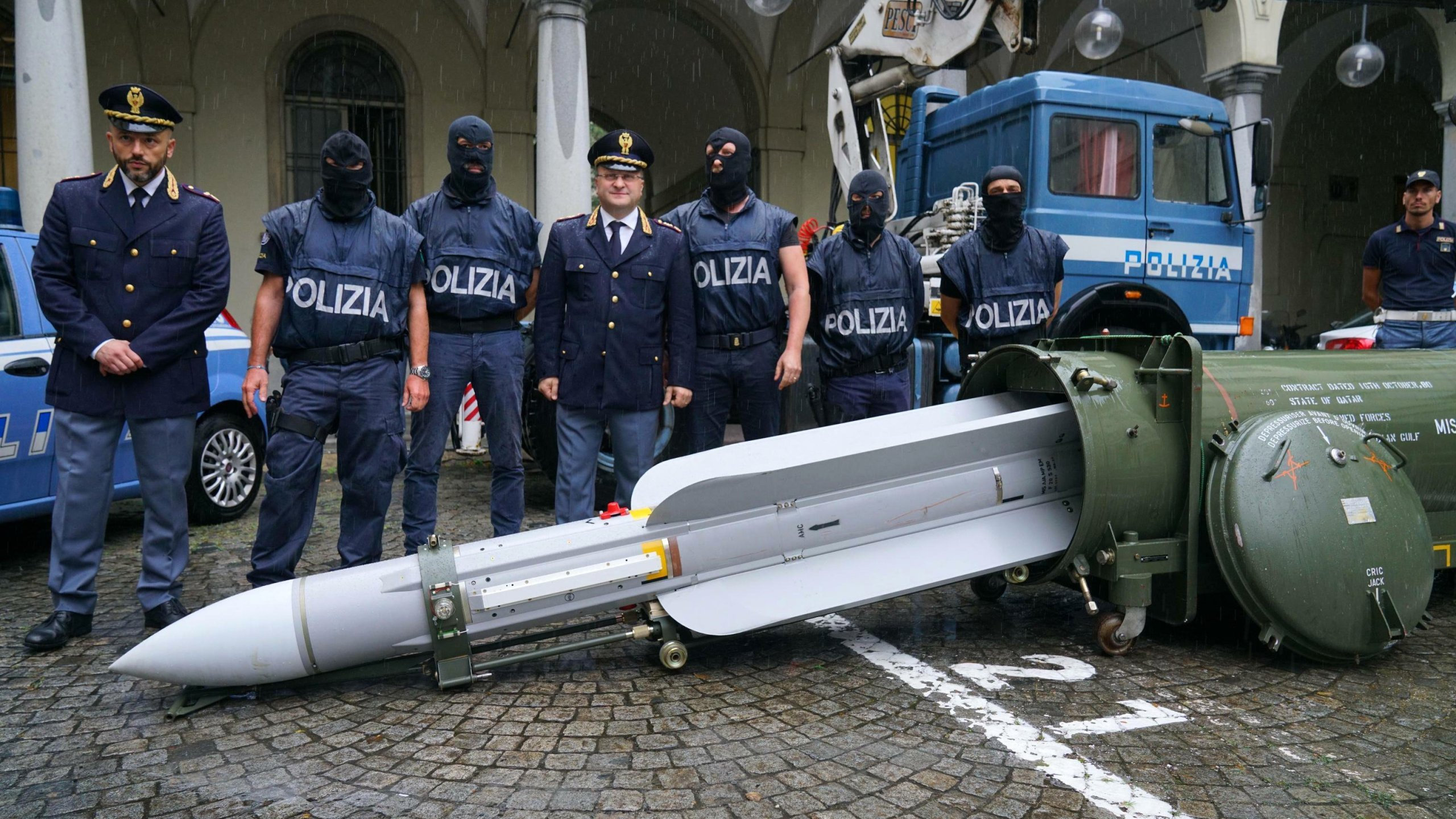 "Italian police have seized ""an arsenal of military weapons,"" including an air-to-air missile, and Nazi paraphernalia from three men, one a former political candidate for an extreme right party. (Credit: Tino Romano/AP)"