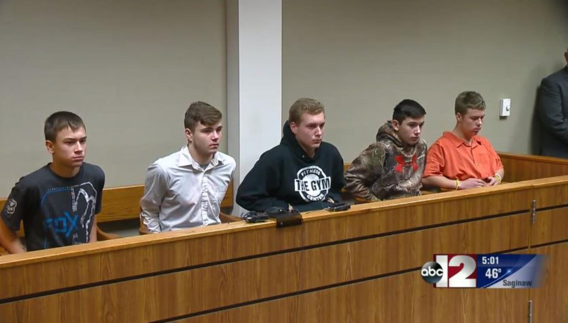 The Michigan teens who pleaded guilty to throwing a rock off a highway overpass are seen in court. (Credit: WJRT)