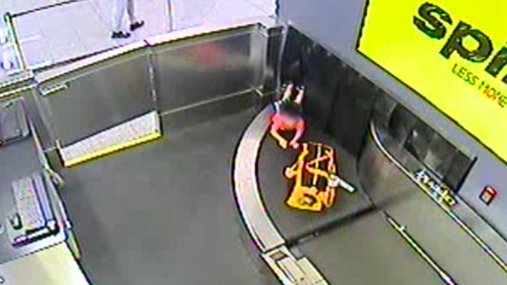 A toddler climbed onto a baggage conveyor belt behind a ticket counter at Atlanta's Hartsfield-Jackson airport. (Credit: Hartsfield-Jackson Atlanta Airport)