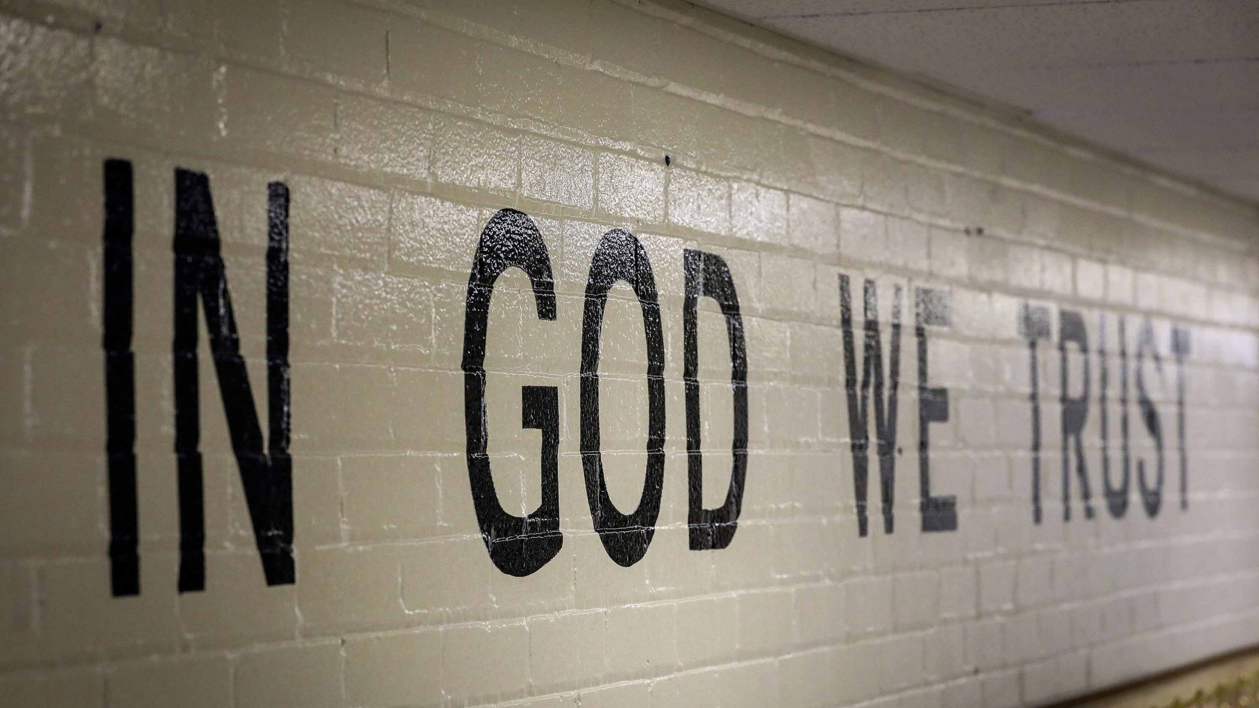 "For the new school year, South Dakota public schools will be required to display the national motto: ""In God We Trust."" (Credit: Adam Fondren/Rapid City Journal/AP)"