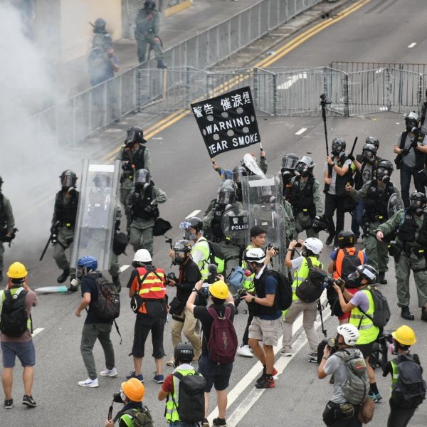Riot police and protesters have become locked in a tense standoff in the small town of Yuen Long, near Hong Kong's border with China, after tens of thousands took to the streets for the eighth consecutive weekend. (Credit: CNN)