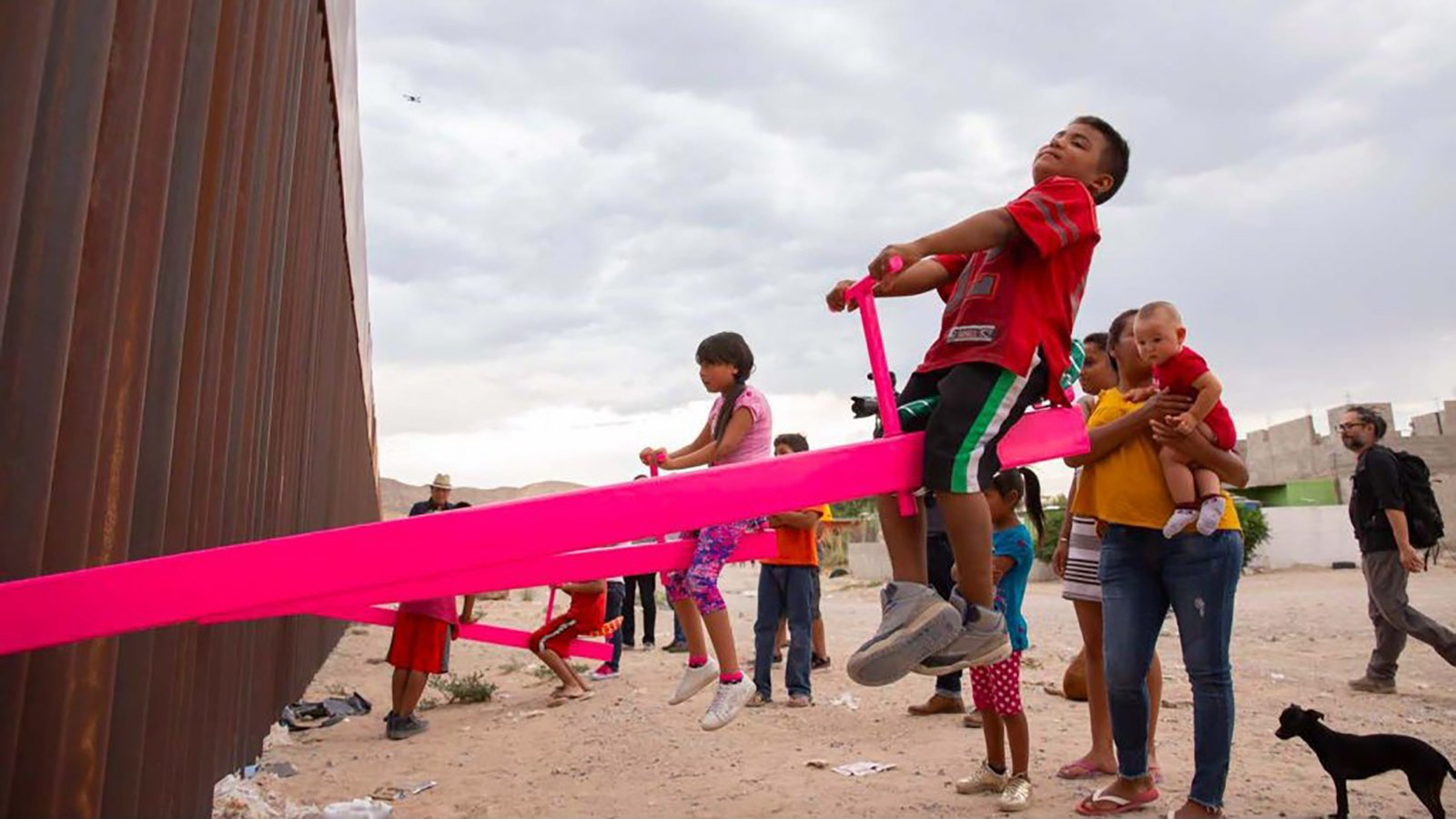 """The """"Teeter-Totter Wall"""" allows children to play with each other in New Mexico and Mexico. (Credit: University of California)"""