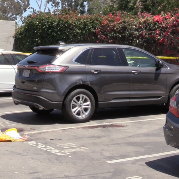 The scene of a homicide in Huntington Beach is taped off for investigation on July 1, 2019.