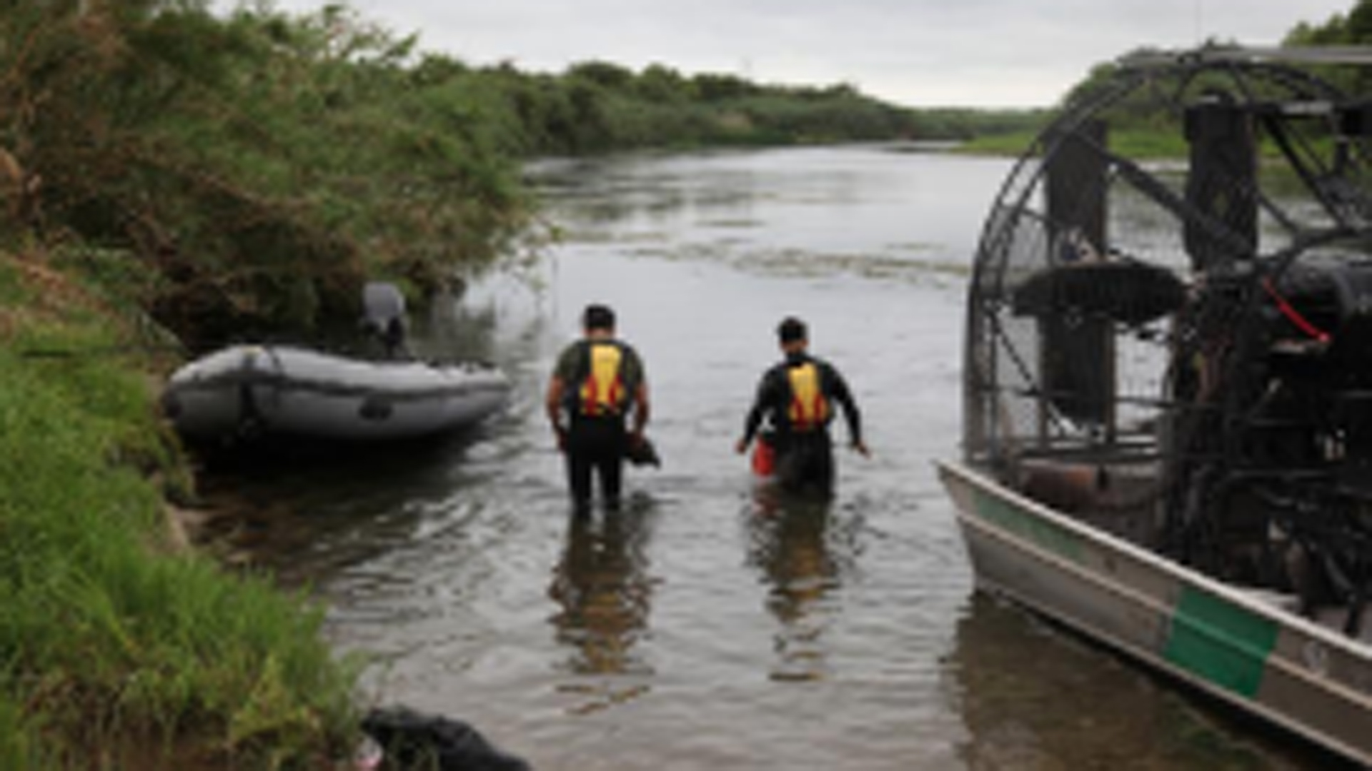 In this photo released by CBP, a Del Rio Sector dive team can be seen searching for a missing 2-year-old girl in the Rio Grande River.