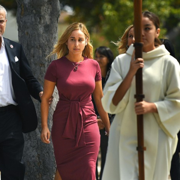 Carli Skaggs walks into St. Monica Catholic Church for a memorial service Monday to honor the life of her late husband, Angels pitcher Tyler Skaggs.(Credit: Christina House / Los Angeles