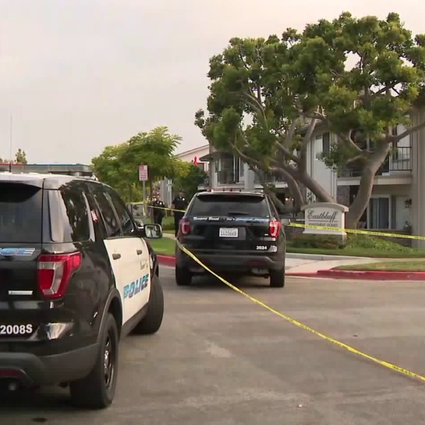 Newport Beach police respond to the scene of a reported domestic disturbance that led to an alleged assault on officers, shooting and standoff on July 7, 2019. (Credit: KTLA)