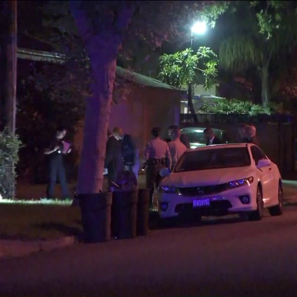Detectives investigate a fatal shooting in Temple City on July 15, 2019. (Credit: KTLA)