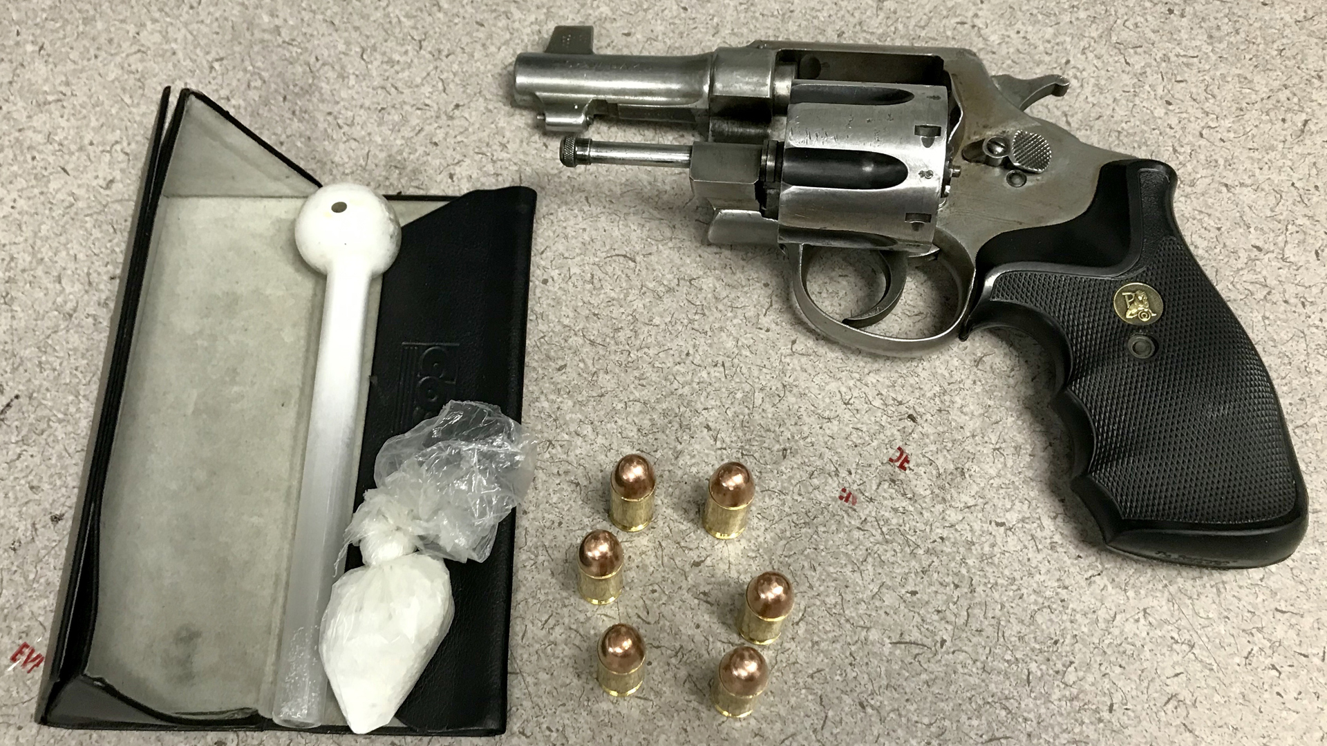 Victorville police released this photo of a handgun and suspected drugs recovered during a traffic stop on July 10, 2019.