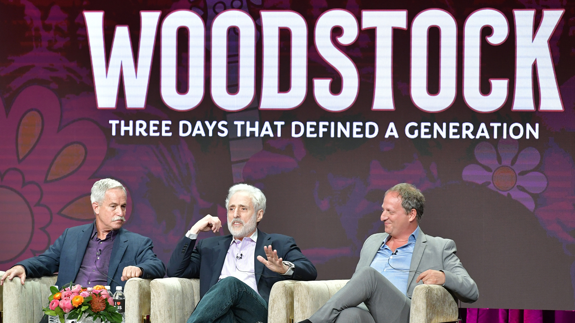 """(L-R) Joel Makower, Joel Rosenman and Barak Goodman of """"Woodstock: Three Days that Defined a Generation"""" speak during the 2019 Summer TCA press tour at The Beverly Hilton Hotel on July 30, 2019 in Beverly Hills, California. (Credit: Amy Sussman/Getty Images)"""